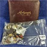 BAG OF BADGES AND BUTTONS AND AUTOGRAPH BOOK WITH WAR REFERENCE