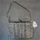 A vintage Gucci ladies evening bag, with black and white beaded design, H.15 W.22cm, with some