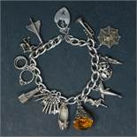 A silver charm bracelet with assorted charms, some marked 925, gross weight approx. 55.4g