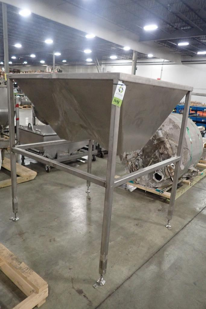 Lot 1048 - SS dual feed hopper, 59 in. long x 49 in. wide x 29 in. deep, SS frame, 70 in. tall overall. **Riggi