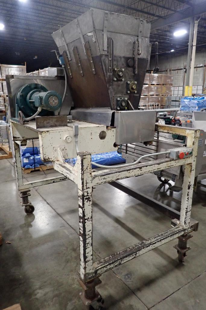 Lot 1025 - 2 roll extruder, 1 meter wide, mild steel frame, on wheels. **Rigging Fee: $50** (Located in 3703 -