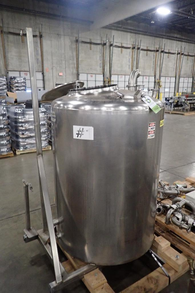 Lot 1063 - Feldmeier jacked tank, 44 in. dia x 55 in. tall, flat bottom, side bottom discharge, skid mounted on