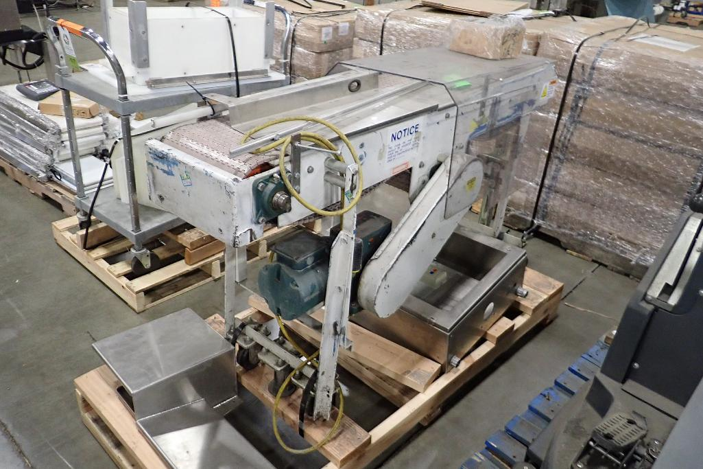 Lot 1016 - Transfer conveyor, 60 in. long x 12 in. wide x 38 in. tall, mild steel frame, motor and drive, on wh