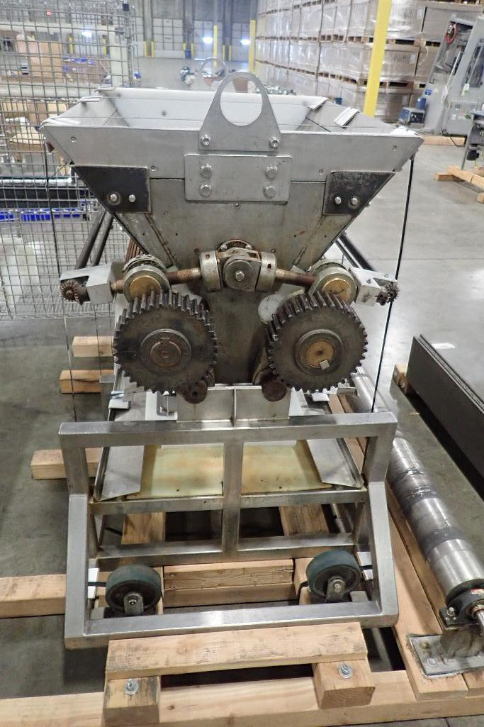 Lot 1023 - Wire cut depositor, 38 3/4 in. wide dual corrugated roller, 1 roll dented, no motor and drive, sitti