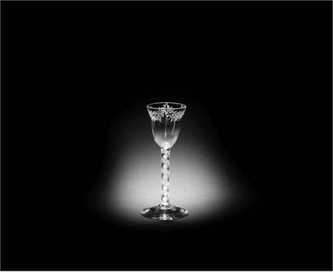 A Beilby enamelled opaque twist wine glass, circa 1765The round funnel bowl painted in opaque white with floral swags, the do