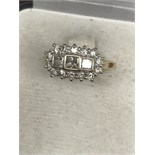 18ct GOLD RADIANT CUT DIAMONDS SURROUNDED BY 14 ROUND CUT DIAMONDS 1.00ct