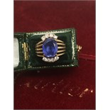 A DRESS RING SET WITH BEAUTIFUL COLOUR LARGE SAPPHIRE +8 WHITE STONES