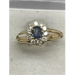 14ct GOLD RING SET WITH HIGH QUALITY SAPPHIRE SURROUNDED BY DIAMONDS - COLOUR F - VS CLARITY