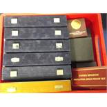 Coin accessories, a large quantity of coin cases many still with empty coin capsules inside for
