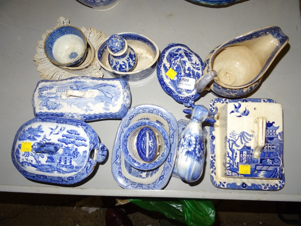 Lot 509 - BLUE AND WHITE WARE INCLUDING BUTTER DISH MILK JUG, PEPPER, LIDDED POTS ETC.