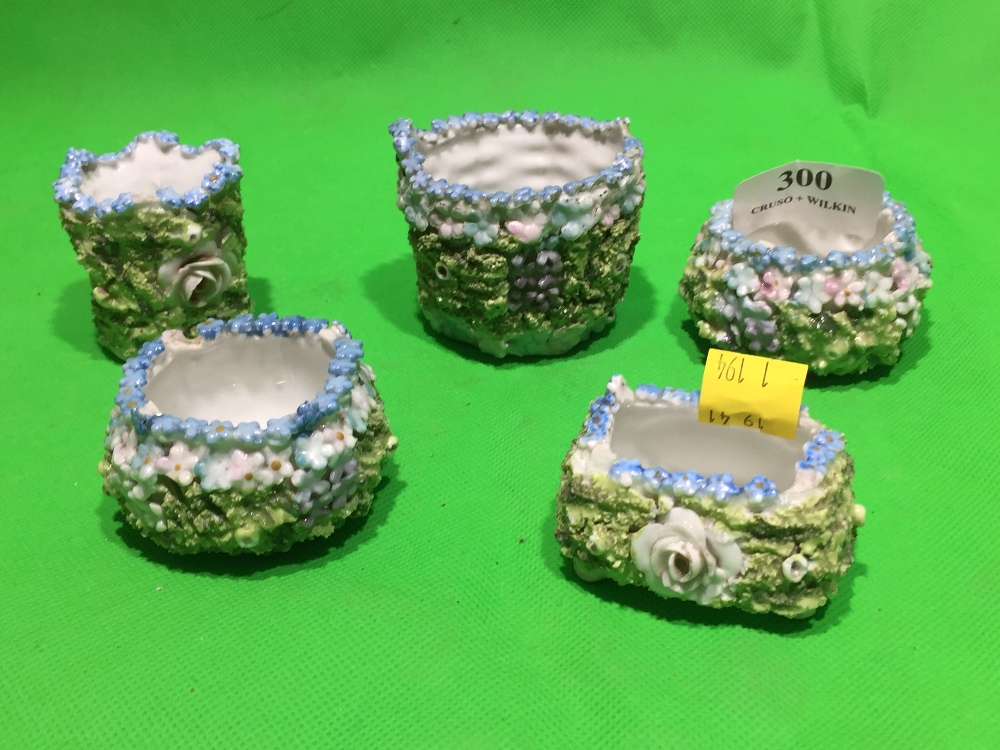 Lot 300 - FIVE PORCELAIN FLOWERED SMALL POTS IN THE STYLE OF THOMAS BEVINGTON