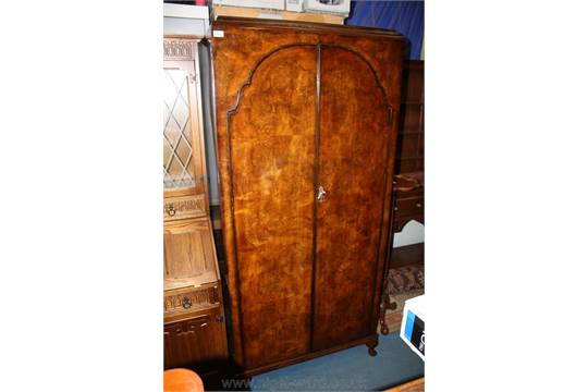 A Double Door Walnut Wardrobe By Palatial Furniture, With Moulded Cornice  Over A Pair Of Well Fig