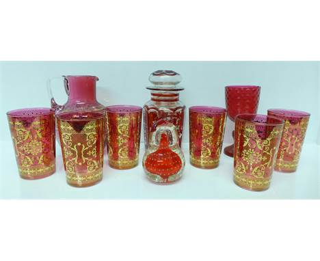Six Italian glass beakers with gilt decoration, a cranberry glass jug, a glass jar, lid a/f, a glass goblet with replacement