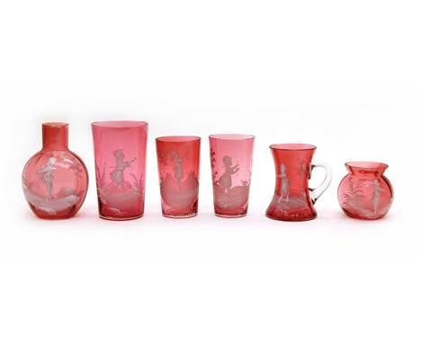 Six pieces of ruby 'Mary Gregory' glass, three tumblers, a waisted tankard, 9cm high, a bulbous vase, 12cm high and a smaller