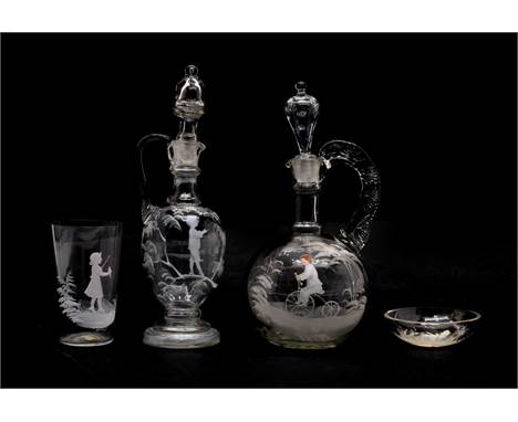 Four pieces of clear 'Mary Gregory' glass, two carafes and stoppers, 26cm and 24cm high, a tumbler and an oval pin trayCondit