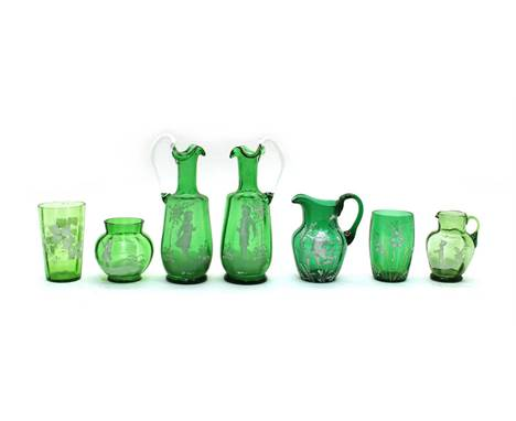 Six pieces of green 'Mary Gregory' glass ware, including a pair of jugs, 18cm high (6)Condition report: Minor rim chips to tu