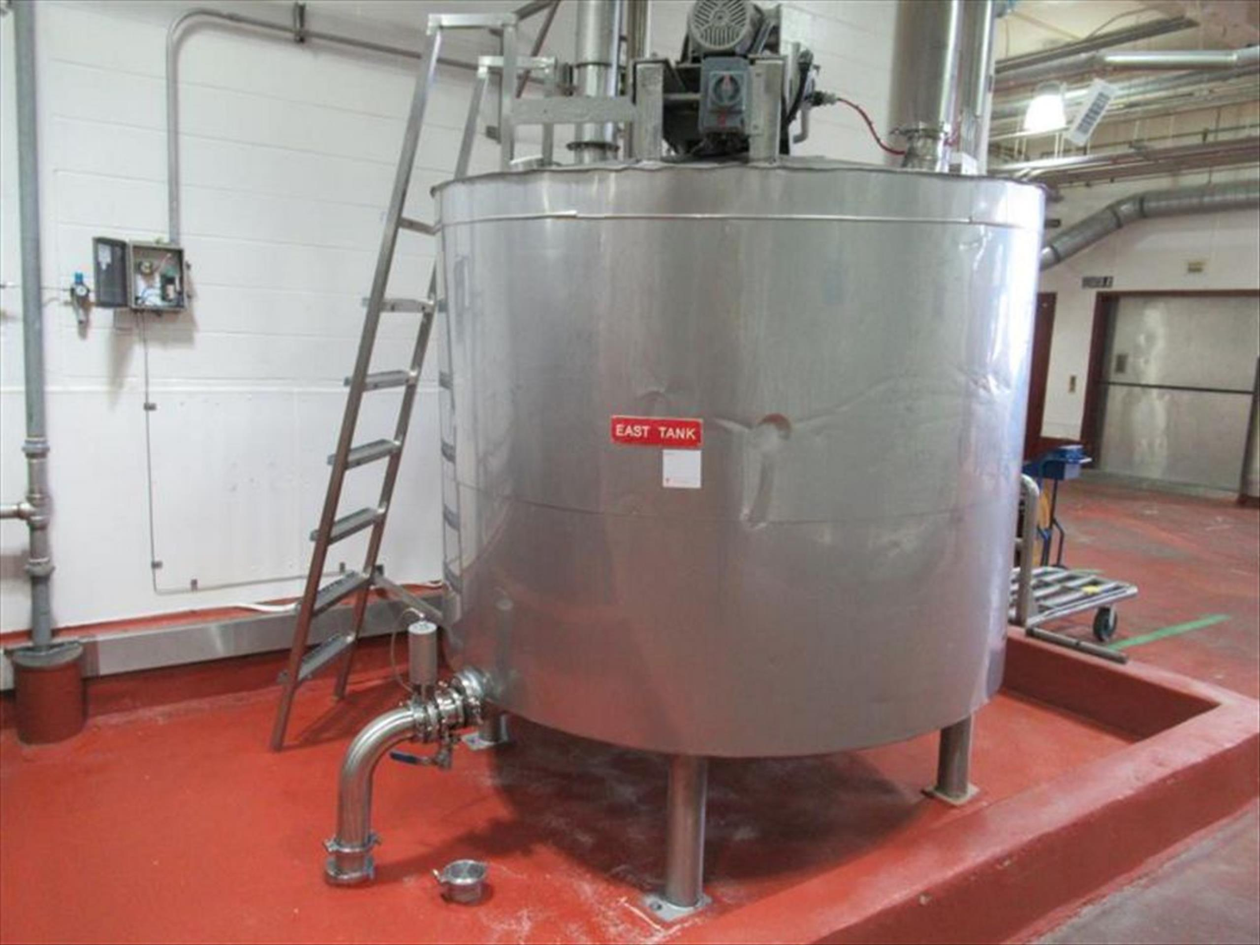East holding stainless tank approx 60 in dia x 75 in h, cone top and bottom, 20 in dia and 16 in mh,