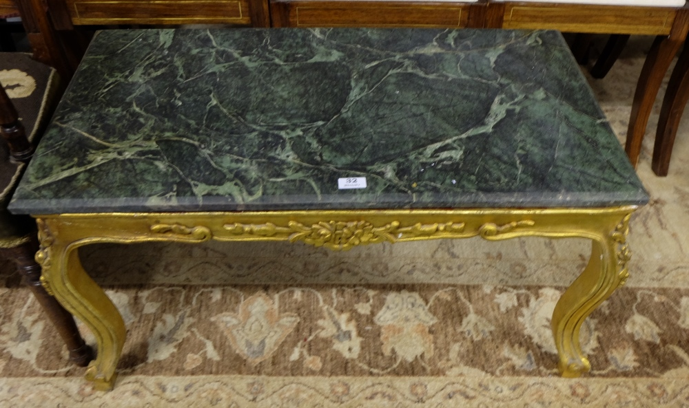 "Lot 32 - Carved Gilt Wood Coffee Table, with raised floral mouldings and green marble top, 35""w x 20""d."