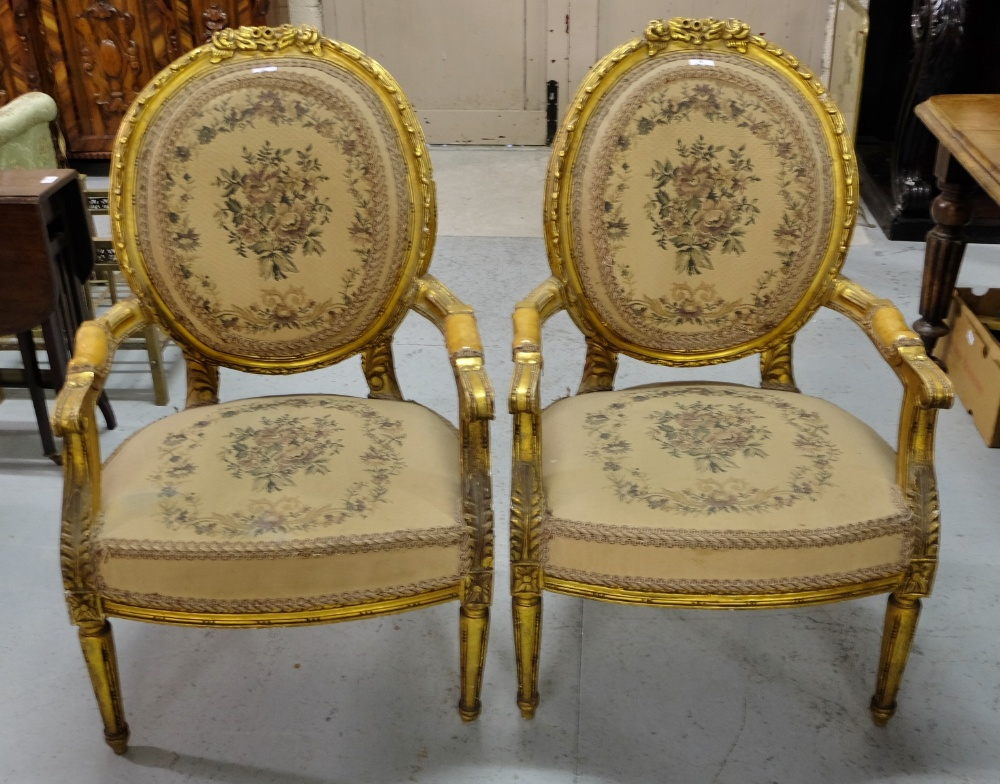 Lot 8 - Matching Pair Carved Gilt Open Armchairs, with floral tapestry seats and backs.