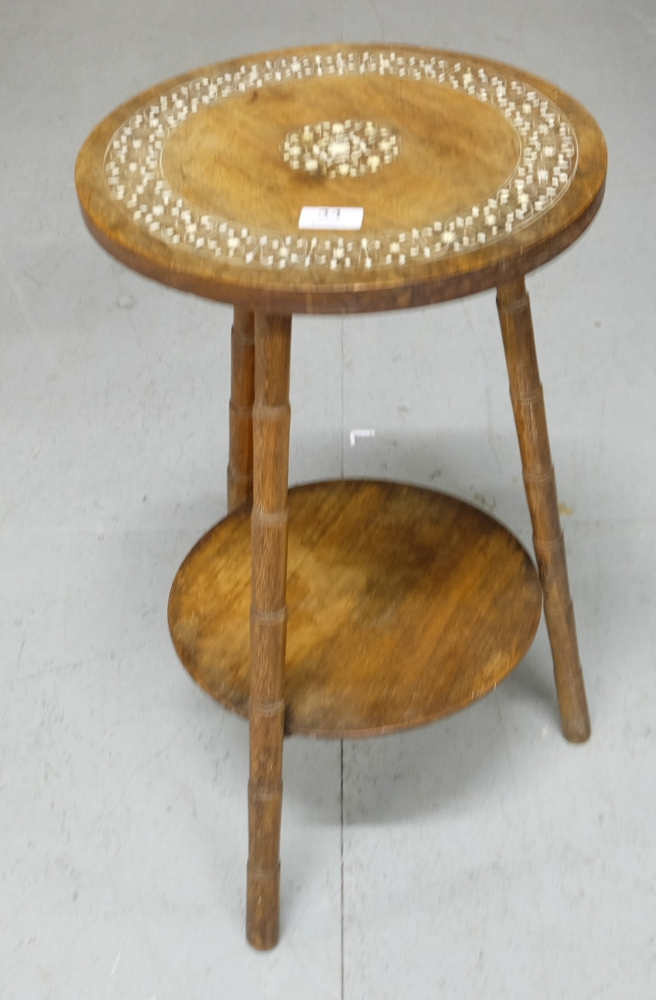 Lot 34 - Low-sized Indian Oak Occasional/Lamp Table, with leaf pattern inlay, on 3 bamboo shaped legs,