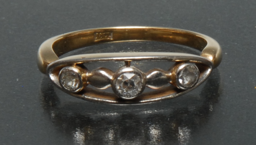 Lot 3043 - An unusual diamond trilogy ring, open arched oval crest mount,