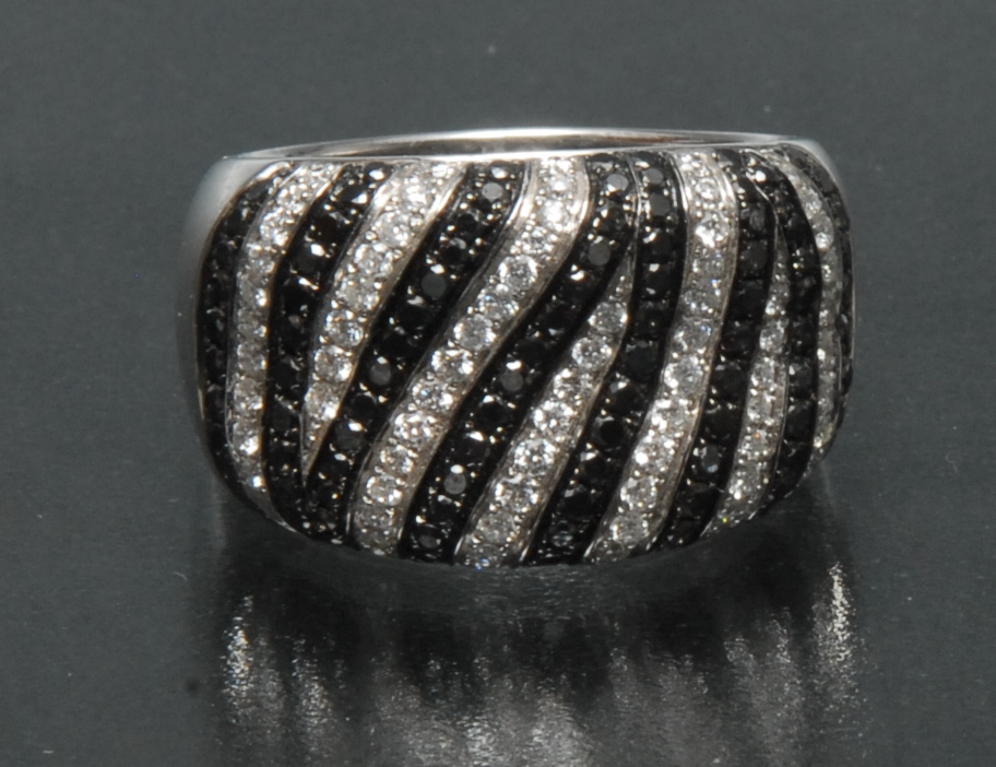 Lot 3046 - A contemporary certified fancy black and white diamond dress ring,