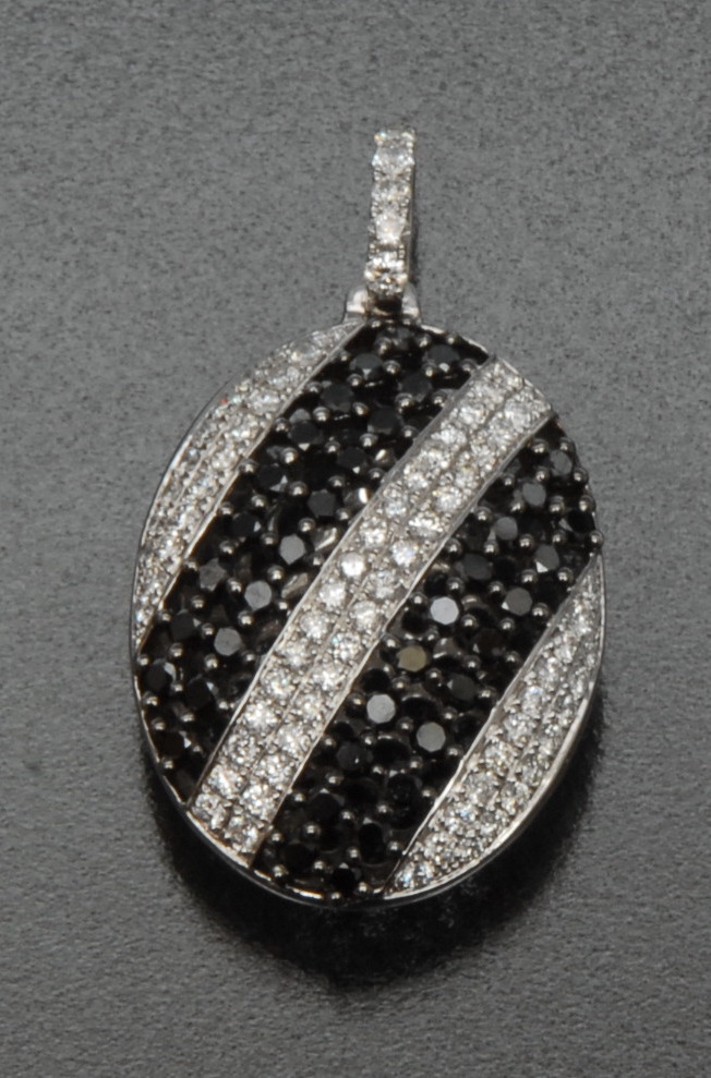 Lot 3054 - A contemporary certified fancy black and white diamond pendant,