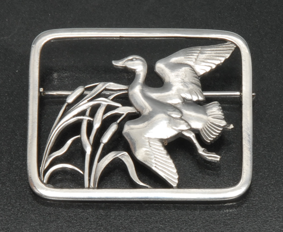 Lot 3061 - A Georg Jensen sterling silver brooch, designed by Hugo Lissberg,