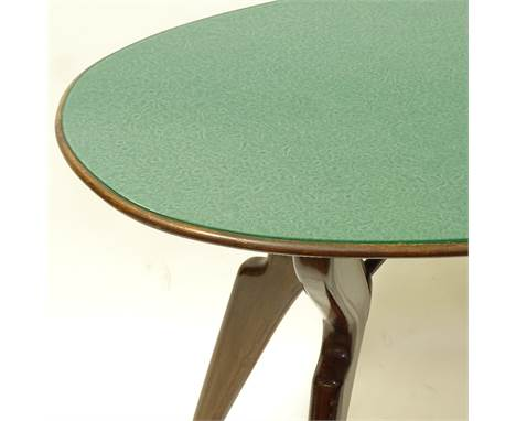 A 1950s' Italian oval dining table, in the manner of Ico Parisi, with stylised wood frame and reverse patterned inset green g