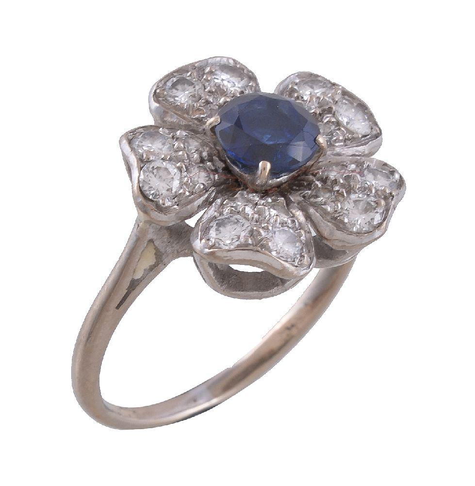 Lot 21 - A mid 20th century sapphire and diamond flowerhead dress ring