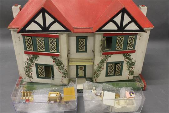A Gee Bee Tudor Style Dolls House Together With A Small Collection Of Dolls  House Furniture