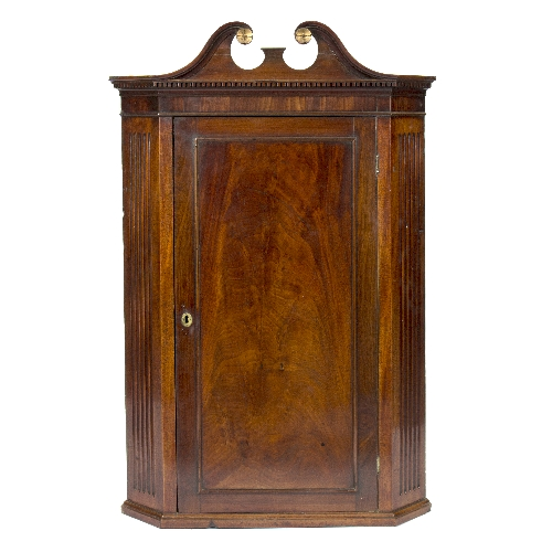 A george iii mahogany corner cupboard with swan neck and for Corner lots more valuable