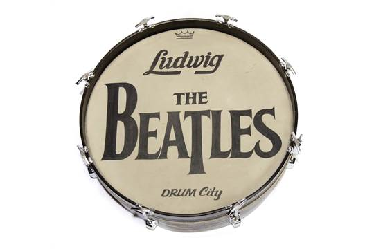 BEATLES BASS 1964 DRUM HEAD FROM MADAME TUSSAUDS A Beatles Drop T