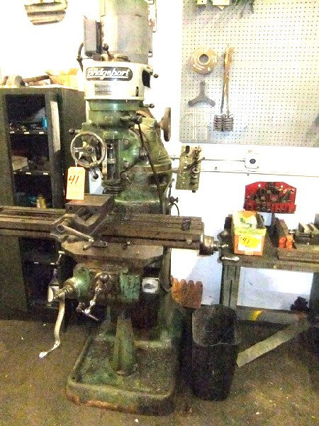 Lot 41 - LOT: BRIDGEPORT ROUND OVERARM MILL MDL J, 1 HP HEAD W/ TABLE & CABINET W/ CONTENTS