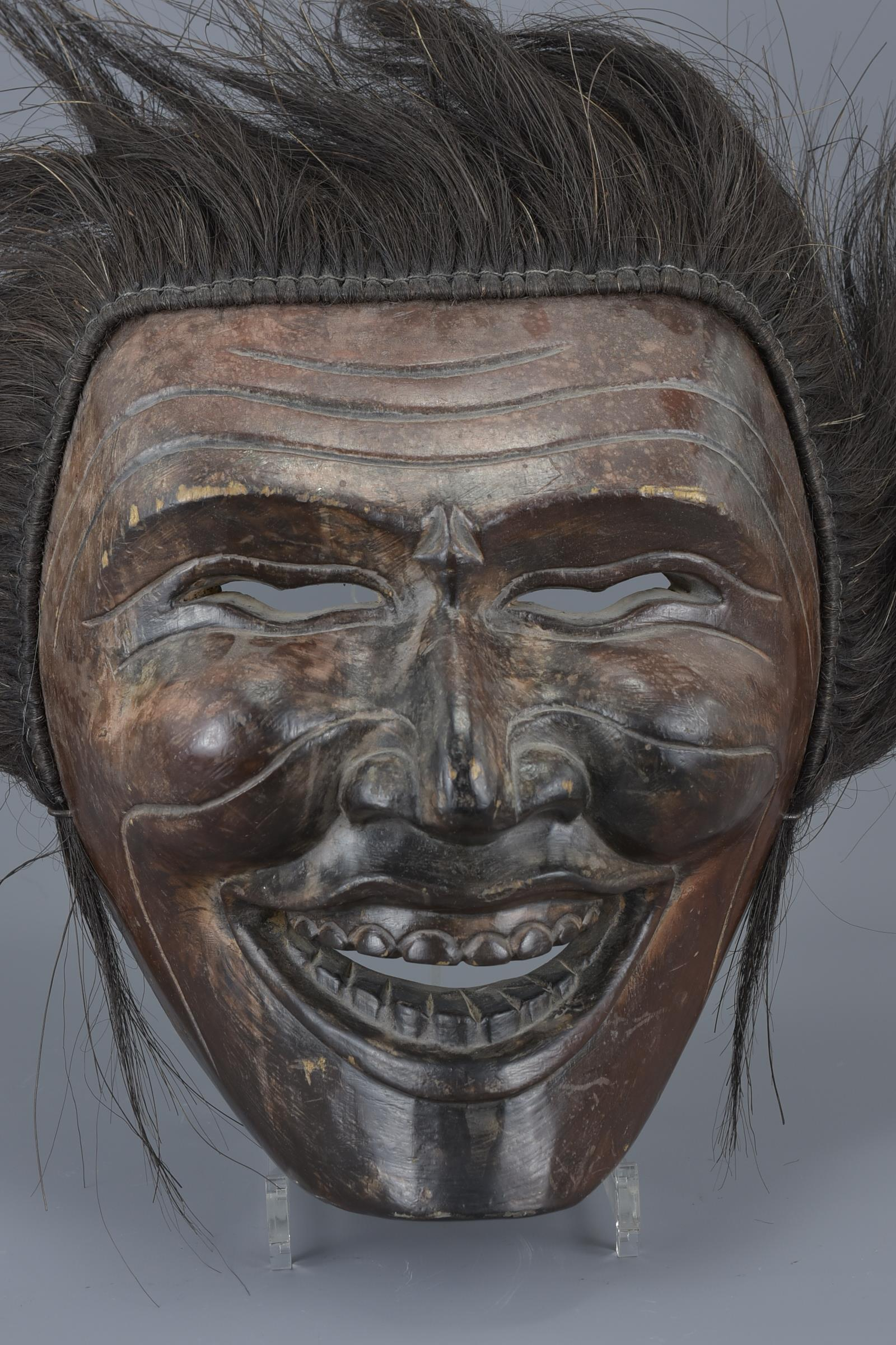 Lot 25 - A large Japanese carved wooden ceremonial mask. 29cm x 25cm