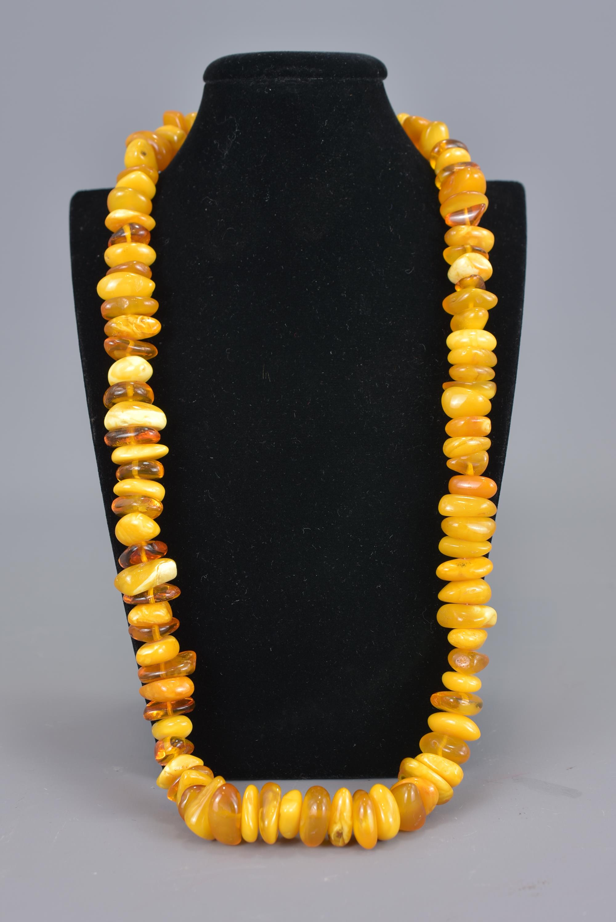 Lot 60 - A string of Baltic amber beads in a necklace.