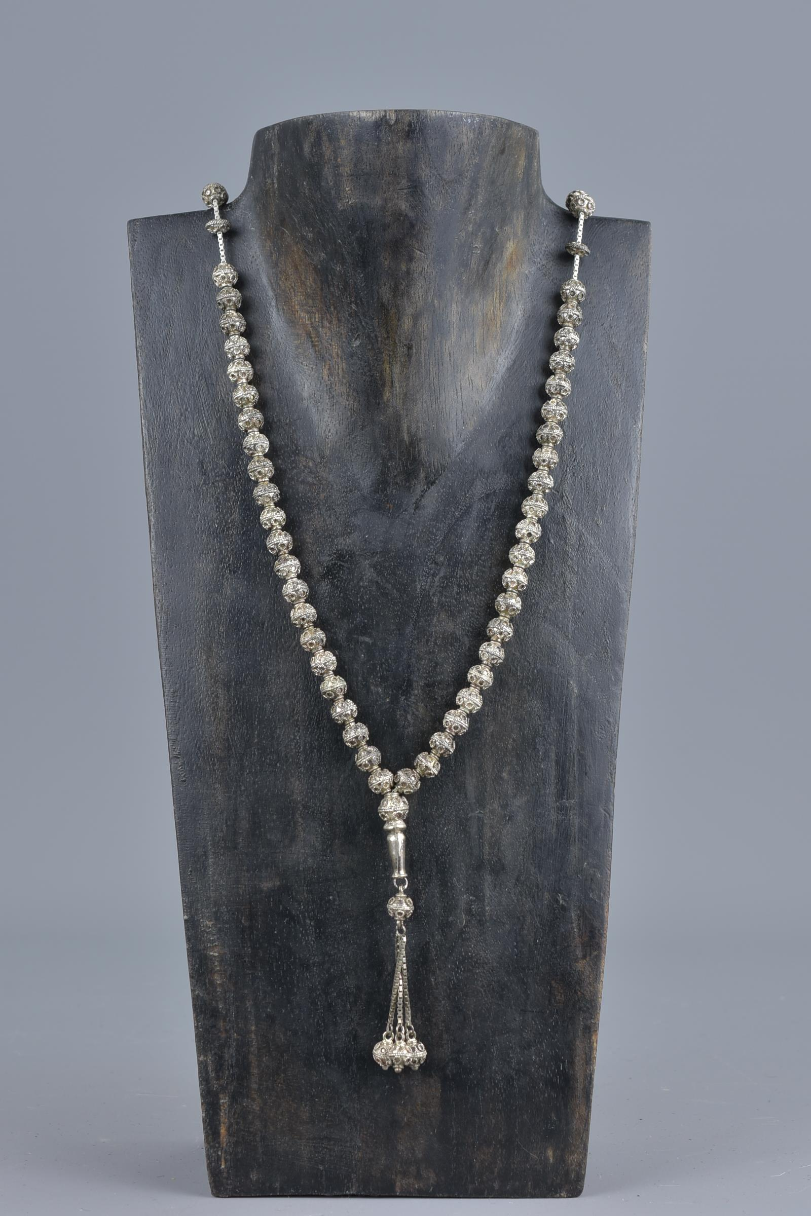 Lot 44 - Islamic 19/20th century silver-coloured metal prayer bead necklace