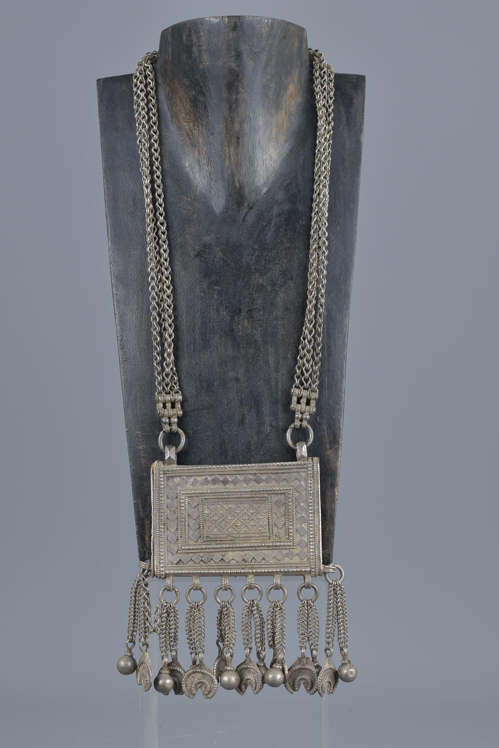 Lot 47 - An Islamic 19th century metal Ottoman prayer box on chain necklace