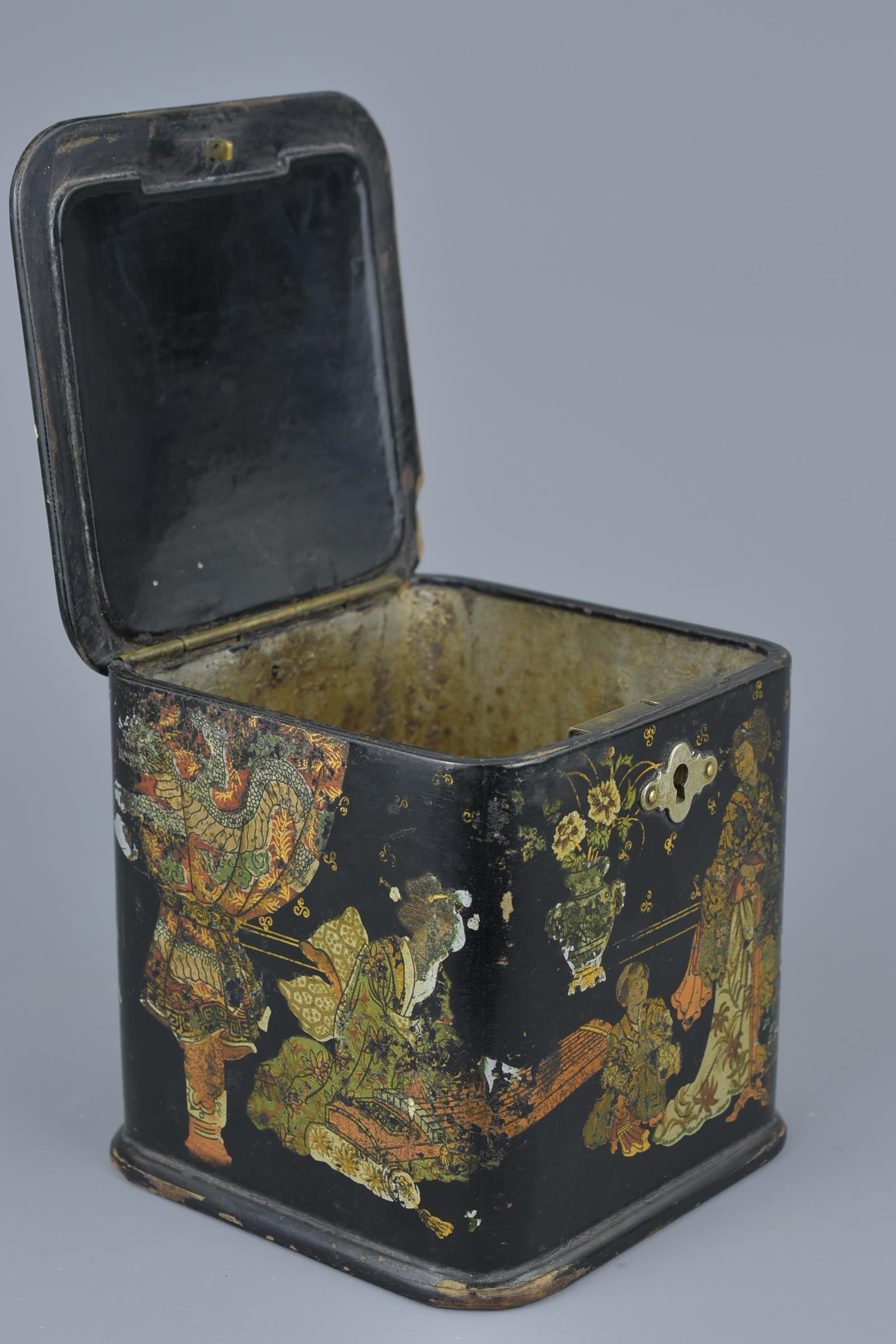 Lot 27 - A Japanese lacquer Tea Caddy with Gold Gilding decorated with figures in garden. 11cm x 11cm
