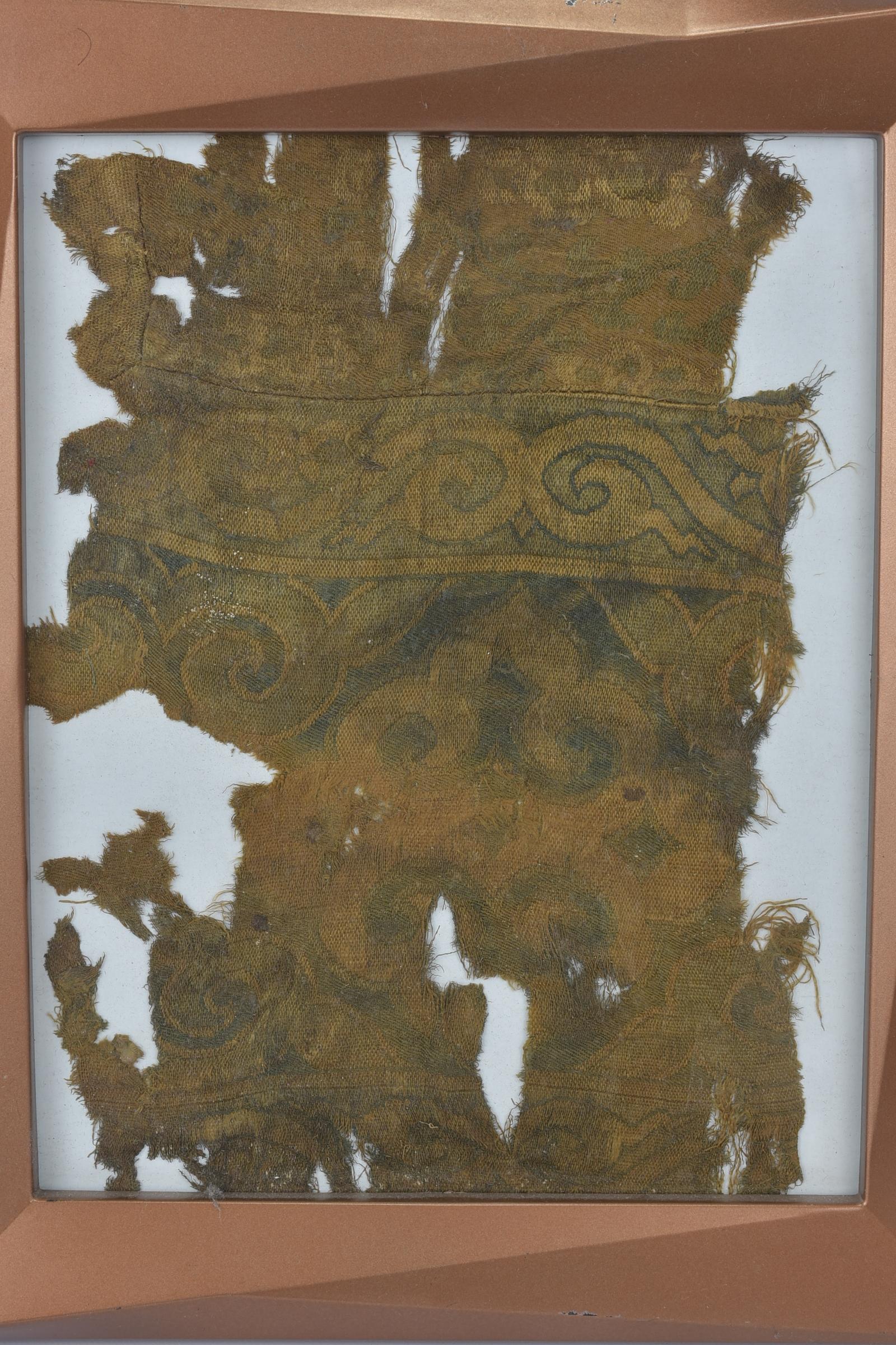 Lot 24 - A framed Tibetan silk fragment. 31cm x 26cm