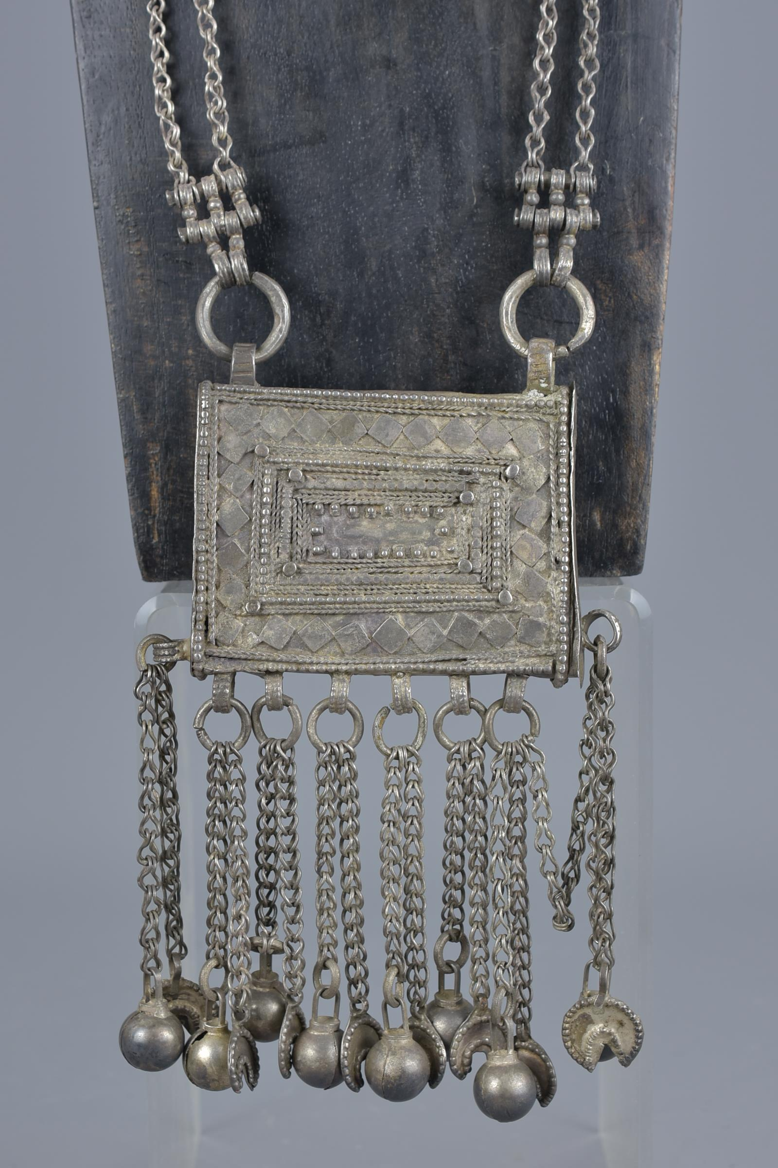 Lot 46 - An Islamic 19th century metal Ottoman prayer box on chain necklace
