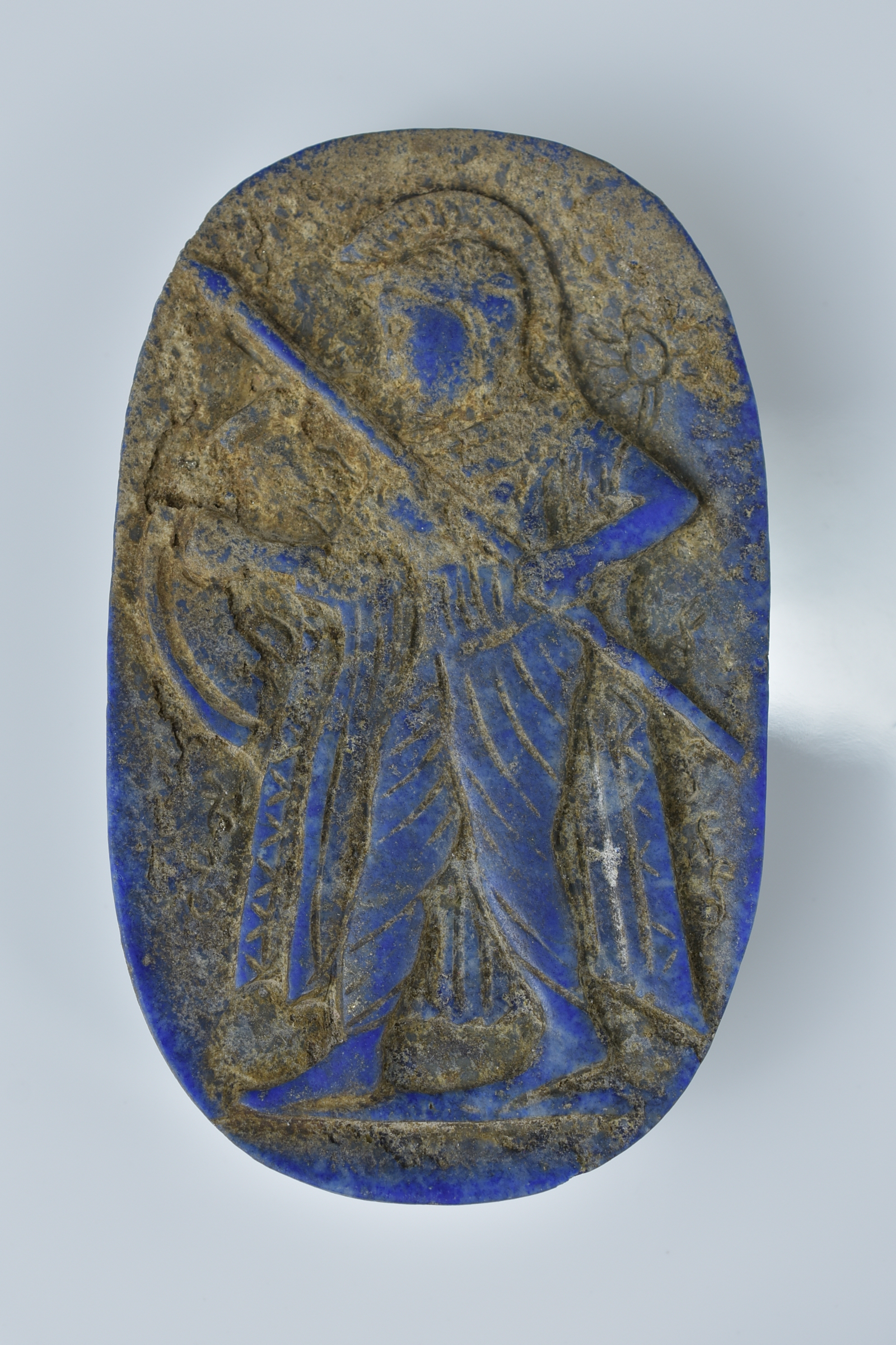 Lot 15 - A lapis carving of a soldier with a spear. 7cm width