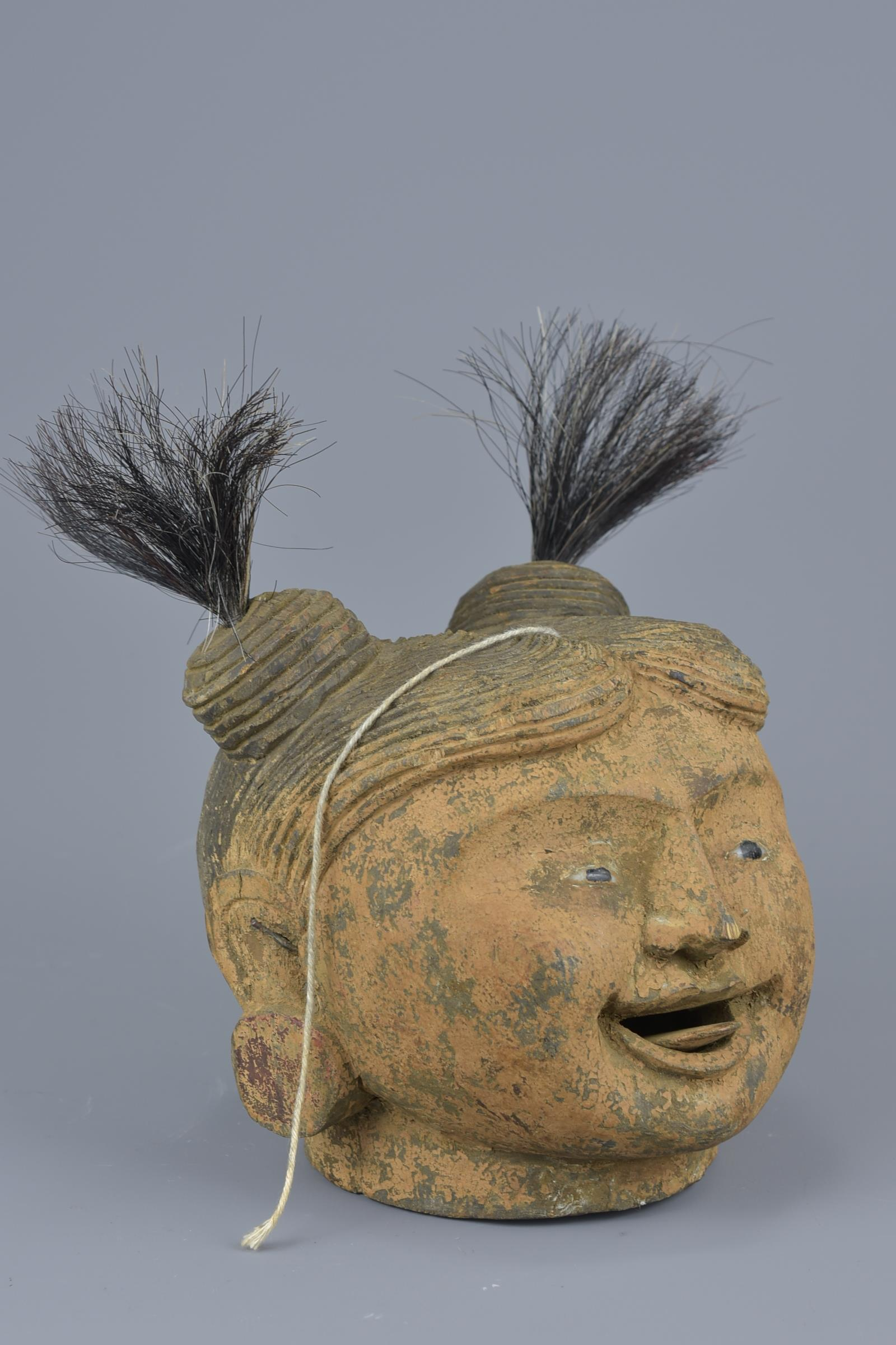 Lot 29 - A vintage wooden puppet head with movable tongue on a string pulley.16cm height