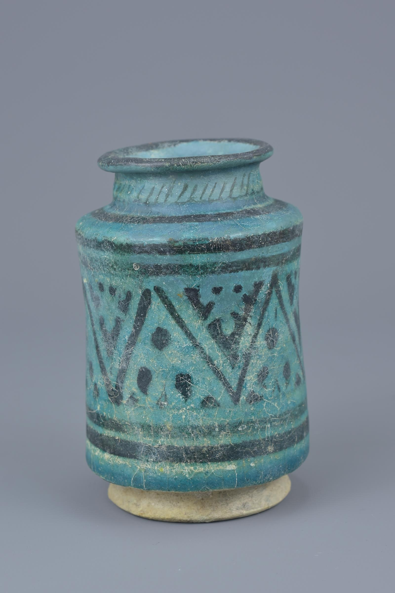 Lot 18 - A Middle Eastern blue-glazed pottery vase possibly 12th century. 12cm height