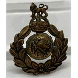 A WWII style Royal Marine Commando cap badge with hidden compass to reverse.