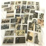 A collection of 50 original WWI postcards to include comical and photographic.