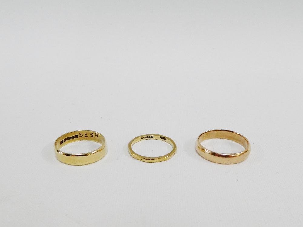 Lot 39 - Three 9 carat gold wedding bands (3)