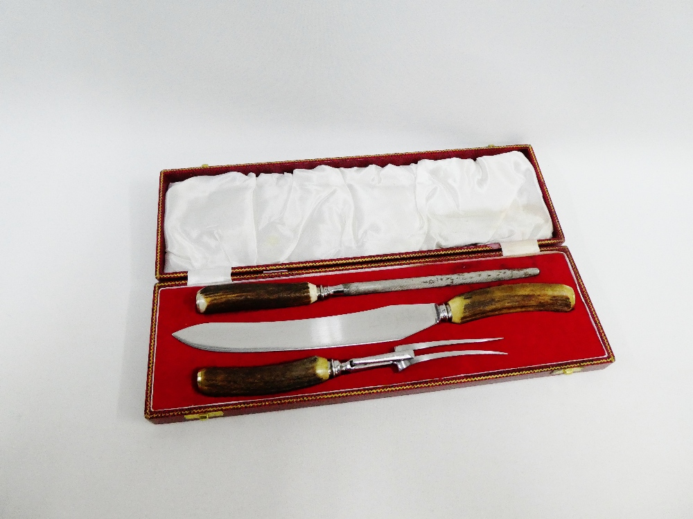 Lot 9 - Horn handled three piece carving set in a red leather fitted box