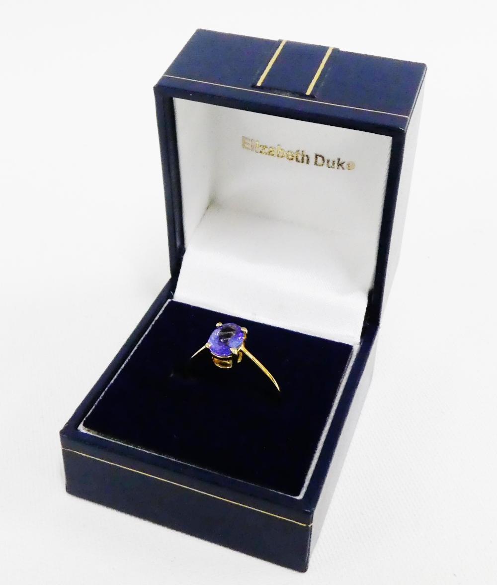 Lot 29 - 18 carat gold tanzanite claw set dress ring, UK ring size O