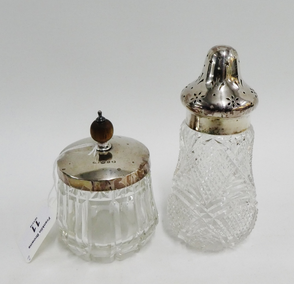 Lot 11 - Victorian silver topped and glass sugar castor, London 1895 15cm high, together with a silver topped